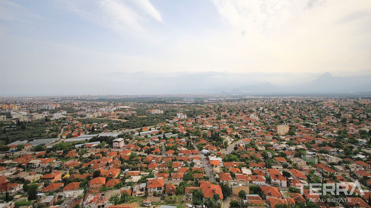 Apartments for sale in Antalya Kepez with a beautiful city and sea vie